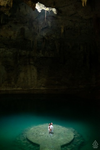 Cenote Suytun Yucatan, MX couple e-session with the cave light coming down from above
