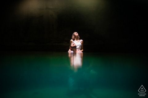 Cenote Suytun Yucatan couple e-session while looking up to the light coming from above