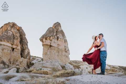 Turkey couple prewed engagement session in Cappadocia with posing in front of the peri bacaları