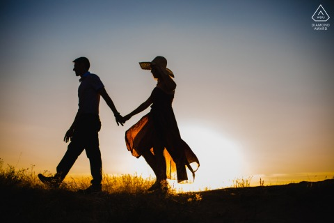 Cappadocia couple prewed engagement session walking by the backlight