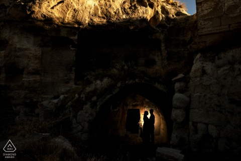 Cappadocia couple pre-wed shoot in a dark hole lightened with an off camera flash