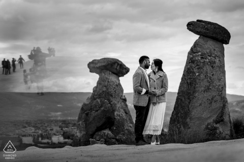 Cappadocia couple engagement session in Turkey with stacked stone ruins in BW