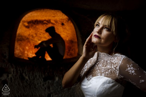 Turkish couple e-shoot in Cappadocia with soft light and a silhouetted groom in an orange arch