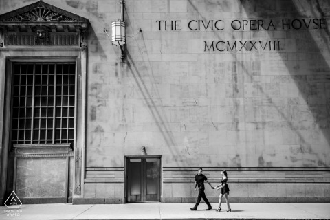 Civic Opera couple e-session in Chicago in BW with a walking pose