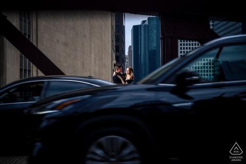 Chicago couple e-session on the urban streets with cars going by