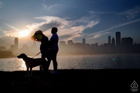 Museum Campus couple e-session in Chicago with a dog in front of the Chicago skyline