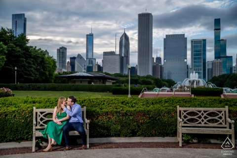 Buckingham Fountain couple e-shoot in Chicago on a bench with the urban city skyline behind them
