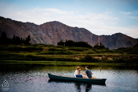 Keystone couple e-session in the Colorado Mountains on the lake aboard the Love Boat canoe