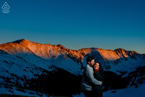 Keystone, Colorado couple e-session during a Winter sunset in the snowy mountains