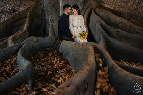 Perth bride and groom to be, sitting for a pre-wedding engagement session on the huge tree roots