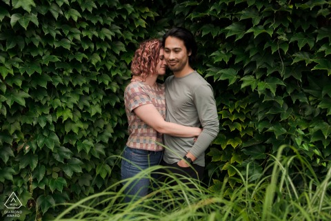 Chicago bride and groom to be, posing for a Garfield Park Conservatory pre-wedding engagement photo shoot