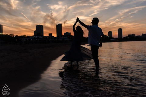 Chicago bride and groom to be, posing for a pre-wedding engagement photo shoot at the North Avenue Beach