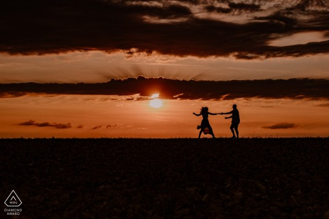 Sancerre bride and groom to be, posturing for an engagement image silhouetted during a Sunset Dance