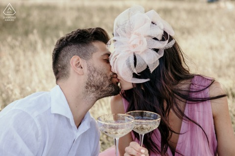 Rimini bride and groom to be, sitting for a pre-wedding champagne toast in the country, during an engagement session