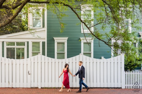 Chicago bride and groom to be, strolling for a pre-wedding picture at Old Town Neighborhood while walking hand in hand next to an old house