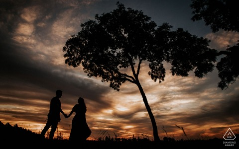 Amambai bride and groom to be, modeling for a pre-wedding picture in Mato Grosso do Sul while walking in the sunset