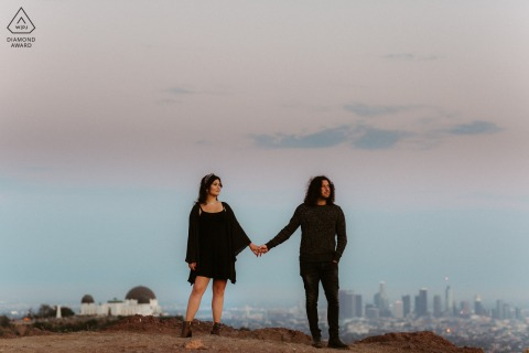 Los Angeles bride and groom to be, holding hands for a pre-wedding picture while Taking in those city views