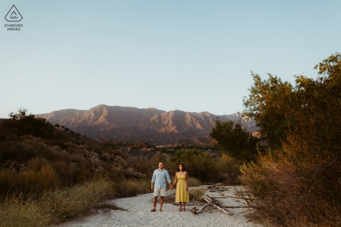 Pasadena bride and groom to be, posing for a pre-wedding engagement photo shoot in the middle of a nature scene