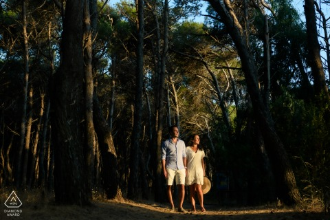 Paestum bride and groom to be, posturing for a pine forest engagement image with a blade of sunset light