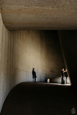Cape Town bride and groom to be, posing for a pre-wedding engagement photo shoot in the concrete structure
