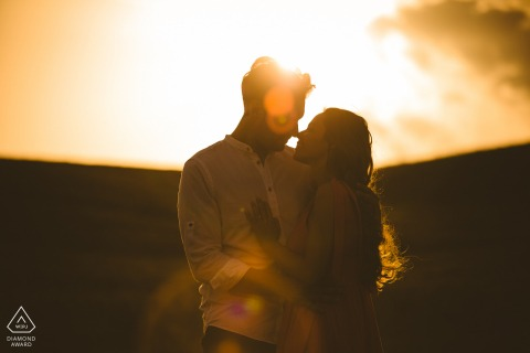 Italian bride and groom to be, posturing for an engagement image in Val d'orcia at sunset