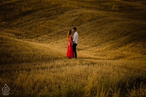 Val d'orcia bride and groom to be, posturing for an engagement image in the wheat field