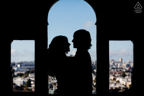 SF bride and groom to be, posturing for an engagement image of the lovers silhouette with the city view as their backdrop