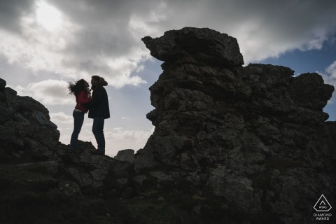 Crozon bride and groom to be, posing for a pre-wedding engagement photo shoot on the rocky cliffs below the clouds