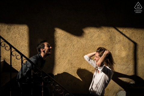 Annecy bride and groom to be, posturing for a France engagement image created in the sunshine shadows