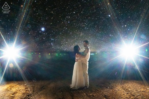 Brazilian bride and groom to be, posturing for a Jatai engagement image at Pontal do Urutau at night with stars and bursts