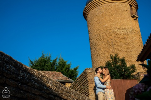 On location Oingt engagement portrait shootCouple session in front of a tower