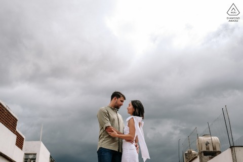 Oaxaca City environmental couple pre wedding image sessionagainst a sky filled with clouds