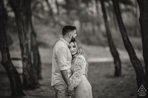 Arraial do Cabo outside environmental couple prewedding photoshoot in BW under the forest trees
