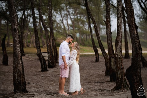 Outdoor Arraial do Cabo, RJ couple engagement photography portrait in tree lined trail in the country