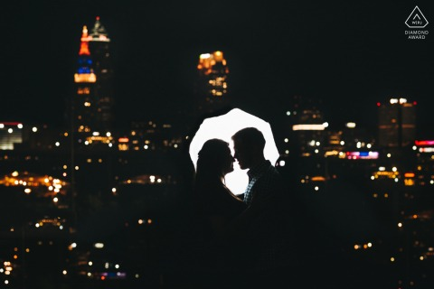 Outdoor Cleveland couple engagement photography portraitsat night above the skyline