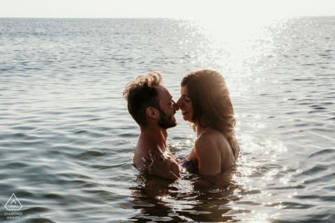 On location Ravenna Wild Beach couple engagement portrait shootat Sunrise deep in the water