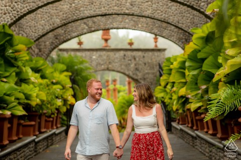 Zephyr Palace, Costa Rica environmental shot of Newly engaged couple walking by trees