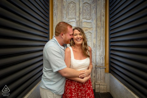 On location Zephyr Palace, Costa Rica engagement portrait shootwith a couple in front of wooden doors