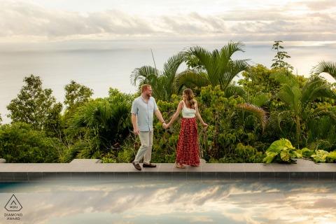 On location Zephyr Palace, Costa Rica couple engagement portrait shootwhile walking hand in hand