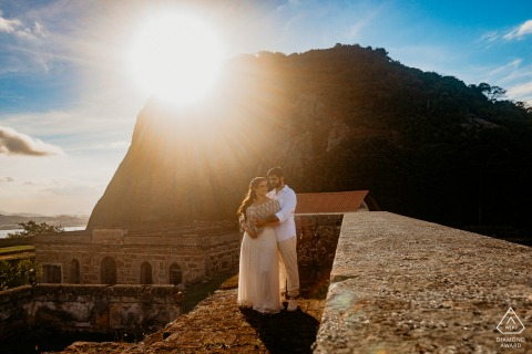 Outdoor Forte São Luiz, Forte do Pico couple engagement photography portrait with sunbeams at the top of the castle