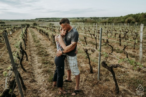 On location Saint Maigrin, France engagement portrait shootwith A couple in the vineyards