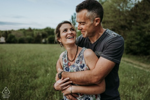 Saint Maigrin, France environmental pre wedding image session witha couple embracing