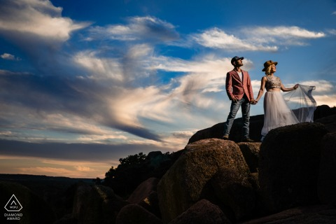 On location Enchanted Rock couple engagement portrait shootat sunset in the State Park