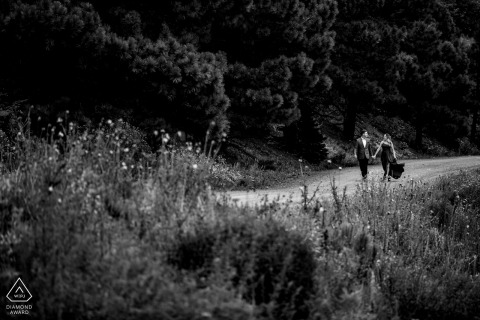 Outdoor Monjeau Lookout, Ruidoso, NM couple engagement photography portrait on a dirt walking trail