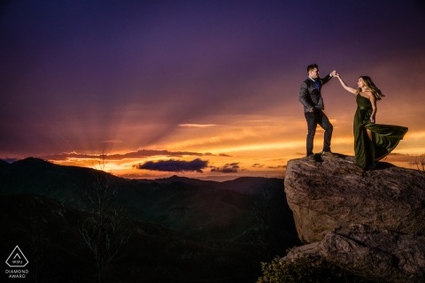 On location Monjeau Lookout, New Mexico couple engagement portrait shoothigh above the sunset of Ruidoso