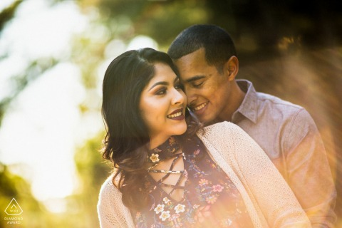 Outdoor Oakland Hill couple engagement photography portraitsin the dazzling sunset flares