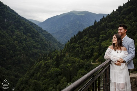 Rize, Turkey outside environmental couple prewedding photoshootfrom a lookout over the mountain valley