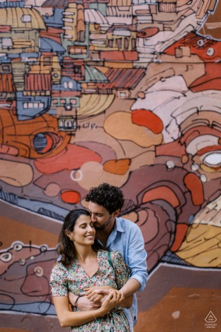 Outdoor Marseille couple engagement photography portraitsagainst a painted art wall