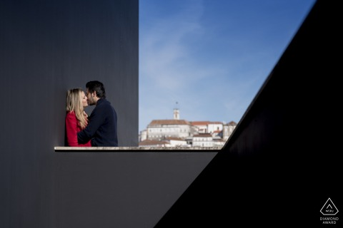 Outdoor Coimbra couple engagement photography portrait using the stairs to put the couple with the city behind