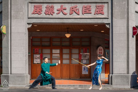 Dadaocheng, Taipei environmental pre wedding image sessionshowing The couple were posing like a fighting video game in front of a historic building